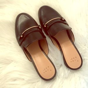 New black & gold backless loafers